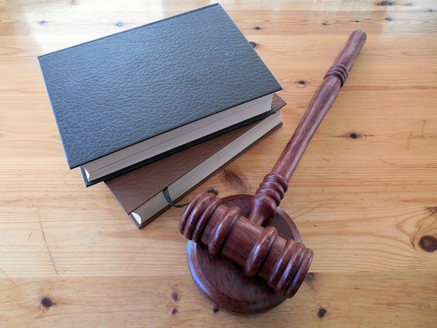 A mallet beside two law books