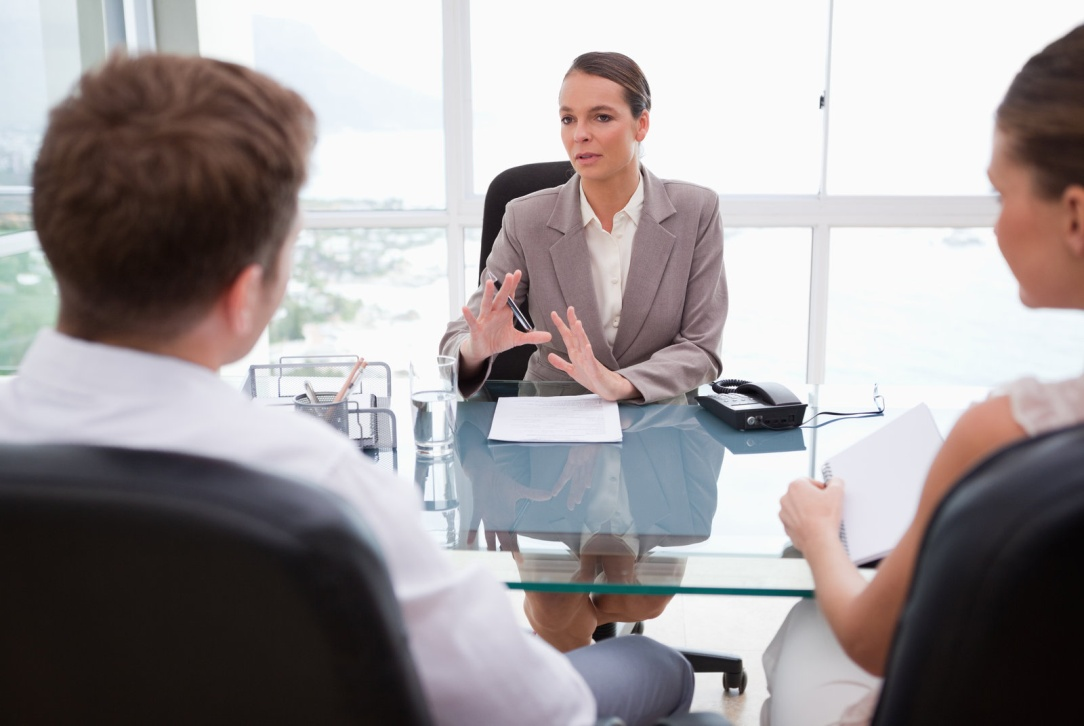 Business owners consulting with an employment attorney.